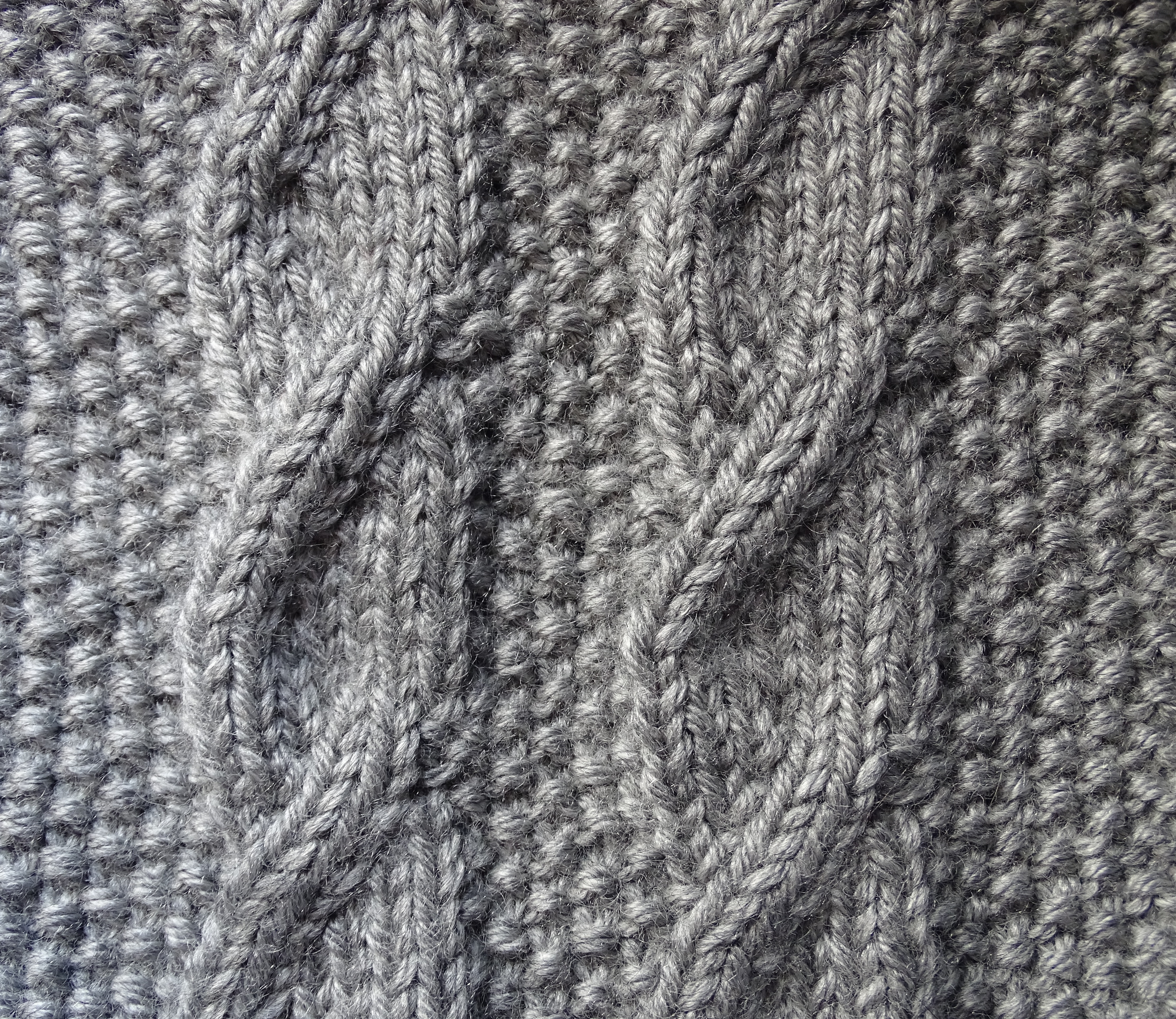 trenzas tejidas a dos agujas sin cruzar los puntos